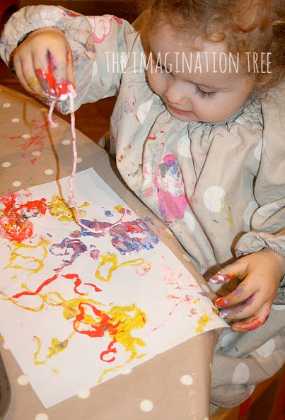 Toddler and preschooler printing activity with spaghetti