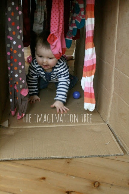 Baby crawl through sensory tunnel