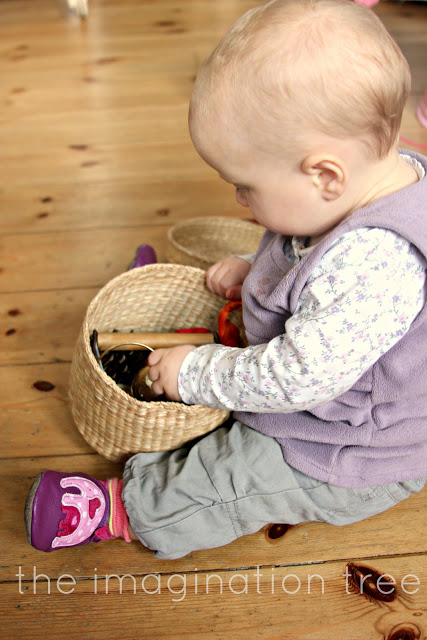 baby playing with a treasure basket montessori reggio emilia