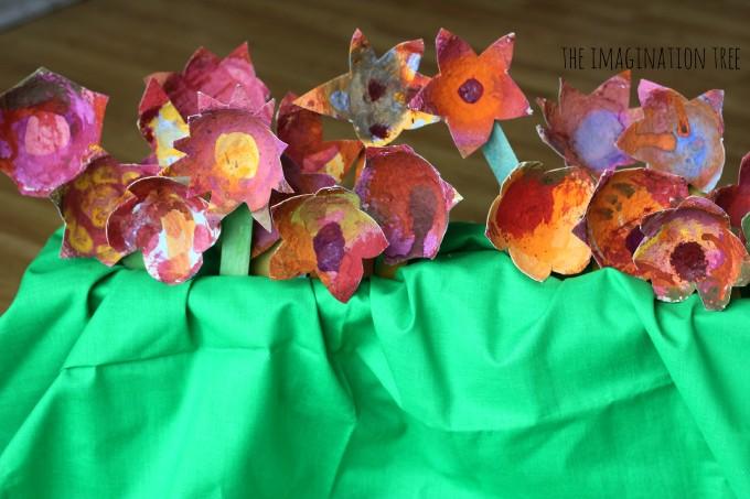 Garden of painted cardboard flowers