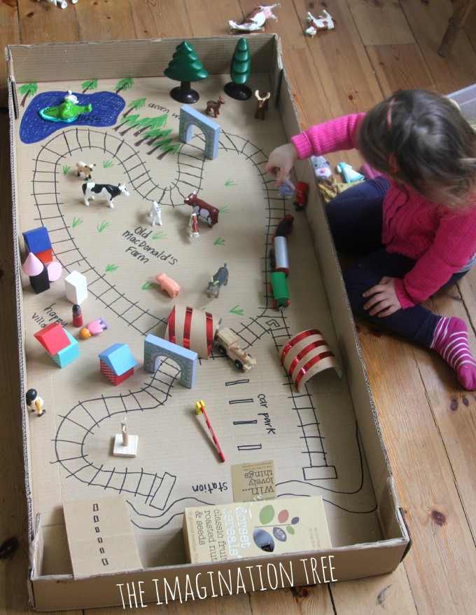 playing with train tracks in box