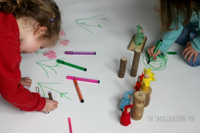 Designing a fairy forest on large paper