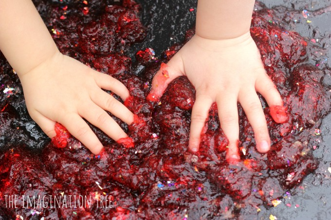 Squishing hands in defrosted jello