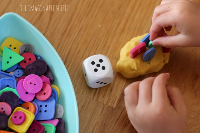 Counting with dice, play dough and buttons