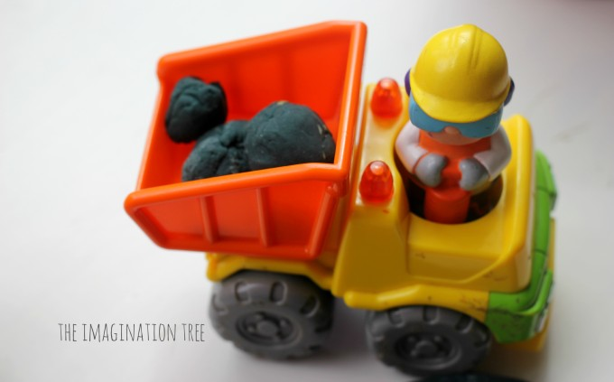 Dumper truck and play dough boulders