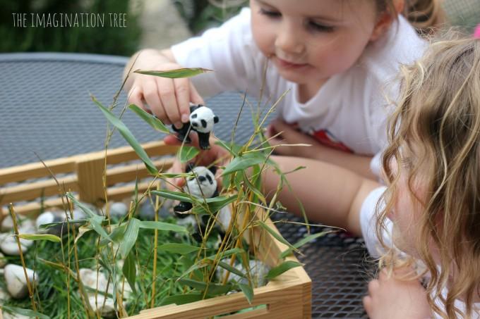Playing with panda bear small world play
