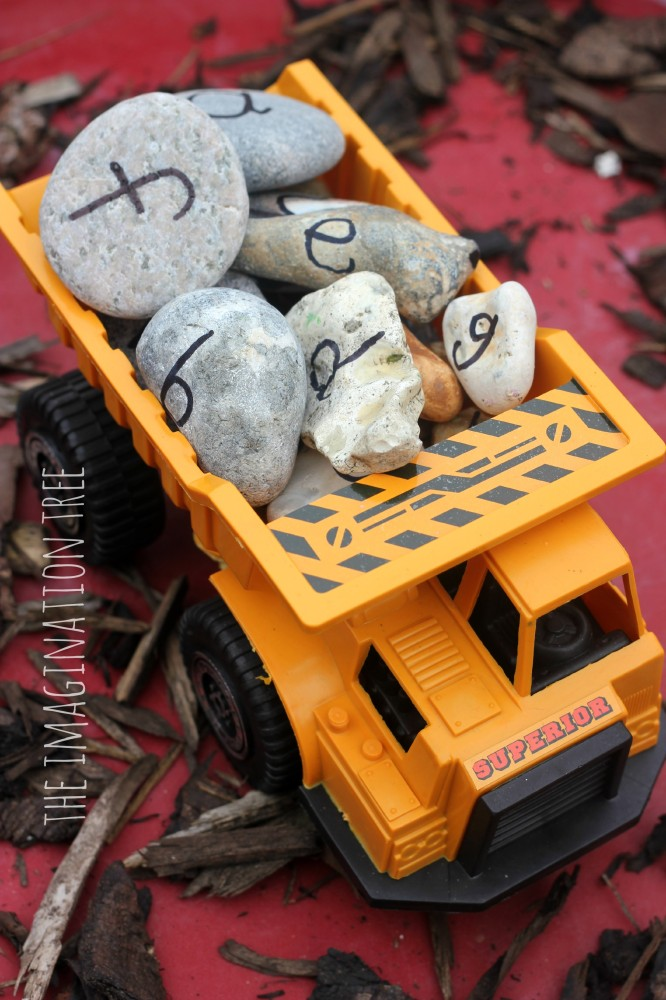 Alphabet rocks in a truck