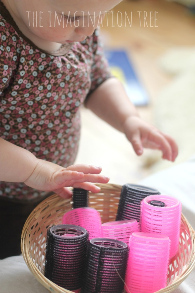 Baby play activity with hair rollers