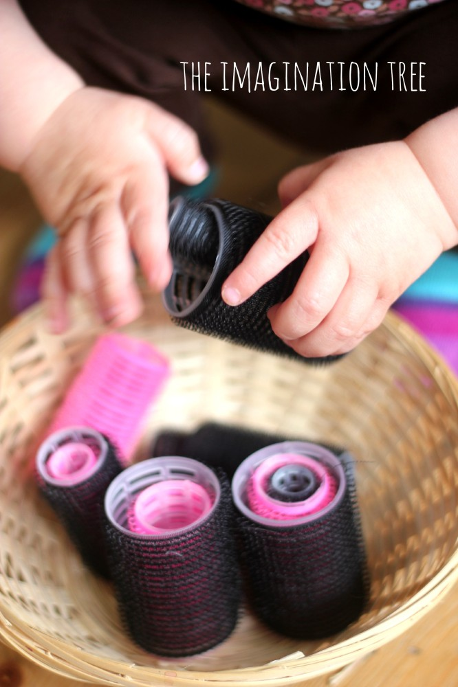 Nesting and posting hair rollers in baby play