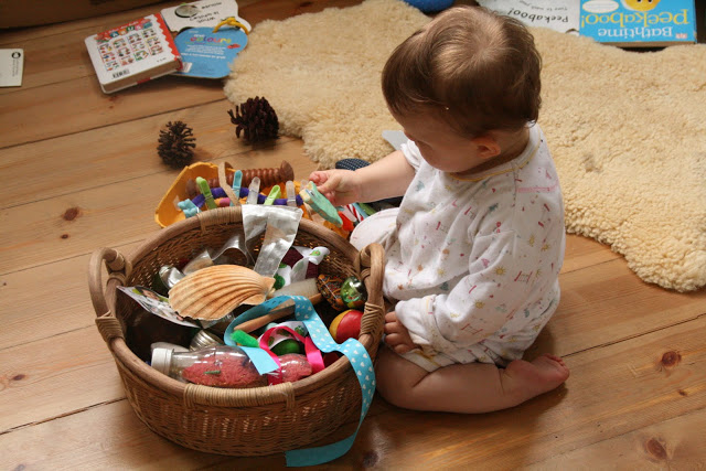 Baby playing with a treasure basket1