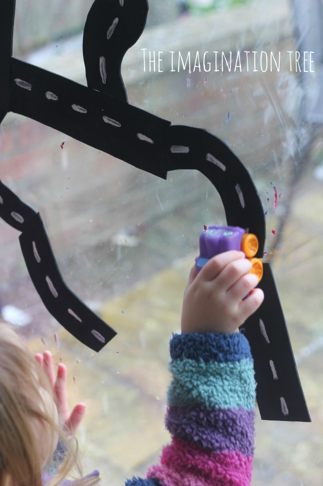 Driving cars on the window activity