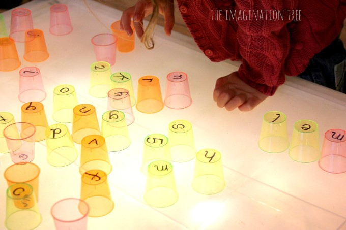 ABC cups on the light table
