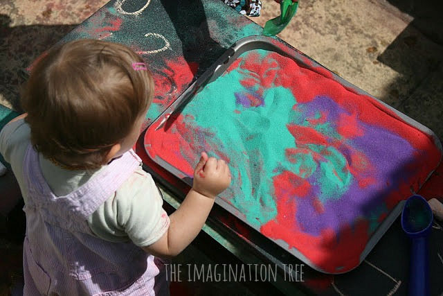 Mixing coloured sand sensory play