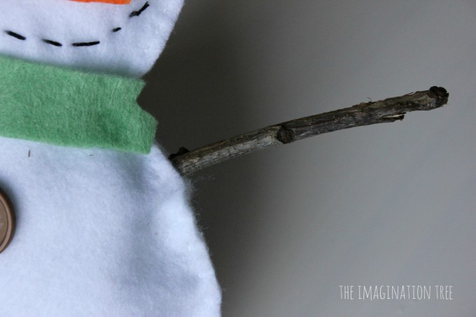 Twig arms in the felt snowman craft