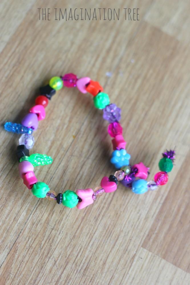 Alphabet threading beads activity
