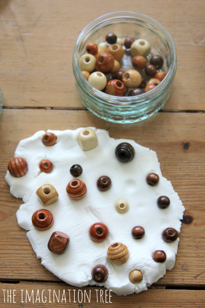 Exploring coconut play dough with natural beads