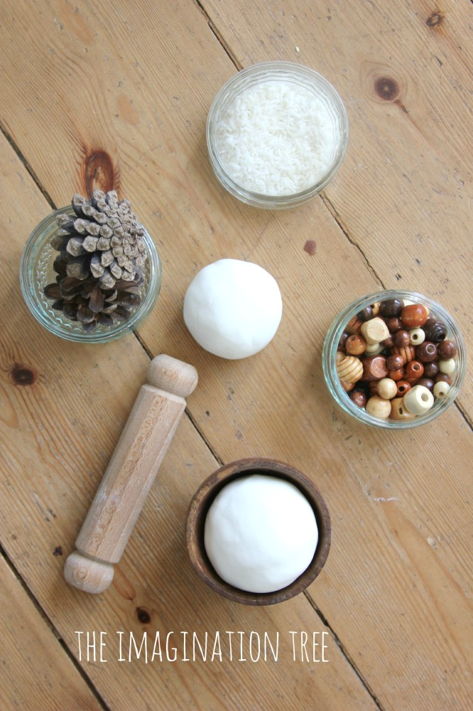 Invitation to play with coconut play dough and loose parts