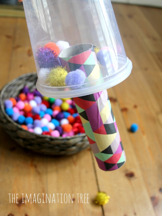 Toddler fine motor play with pom poms