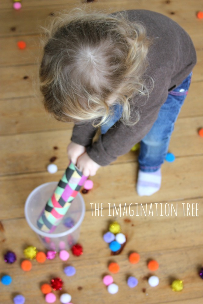 Toddler play activity pom pom drop and shoot game