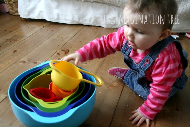 Baby play with stacking nesting bowls