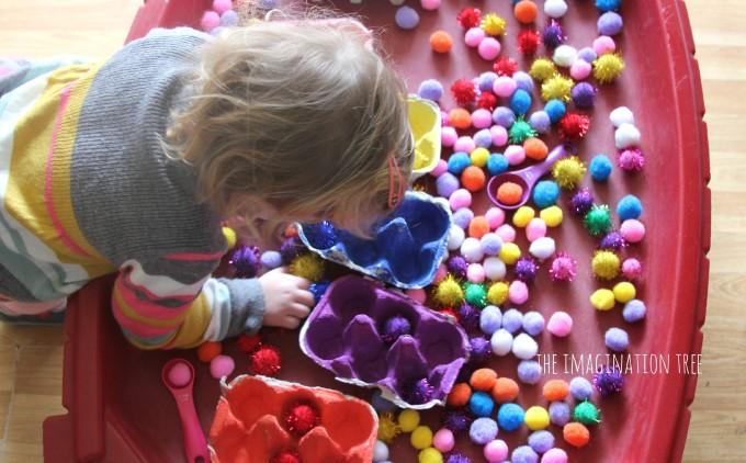 Pom pom colour sorting in the sensory table
