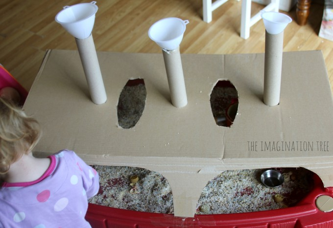 Tubes and funnels box over the sensory table