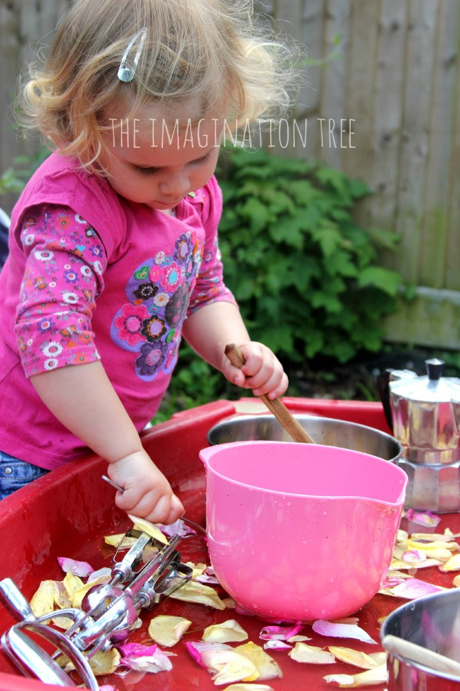 Making concoctions at the sensory table