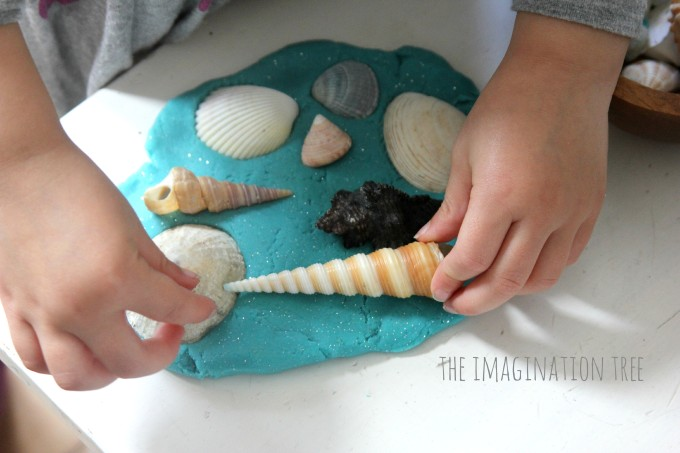 Sea shells in ocean play dough