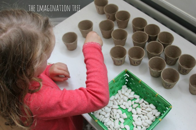 Counting beans into flower pots game