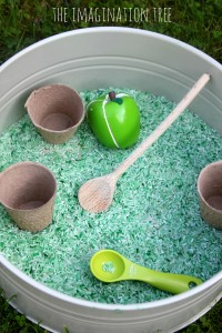 Apple cinnamon scented sensory rice tub for Autumn play