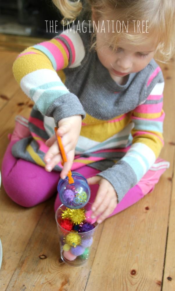 Pom pom transfer fine motor game for preschoolers