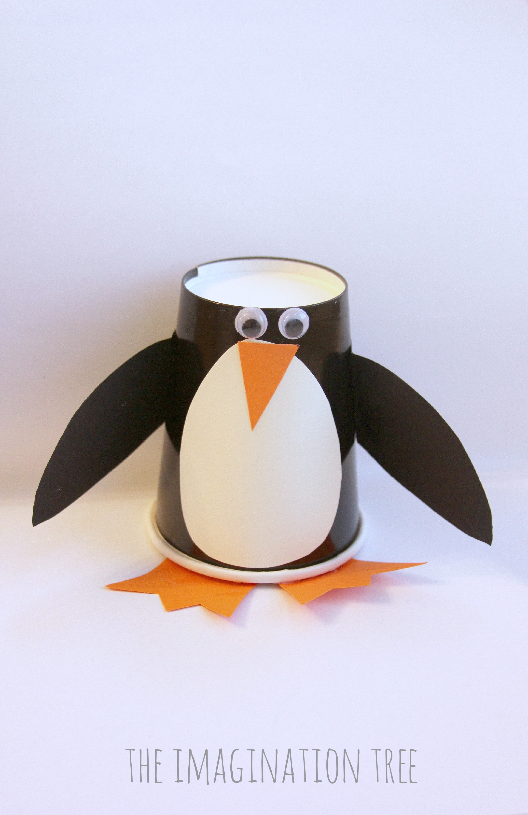 Paper cup penguin craft roll and make game the imagination tree paper cup penguin craft for kids jeuxipadfo Image collections