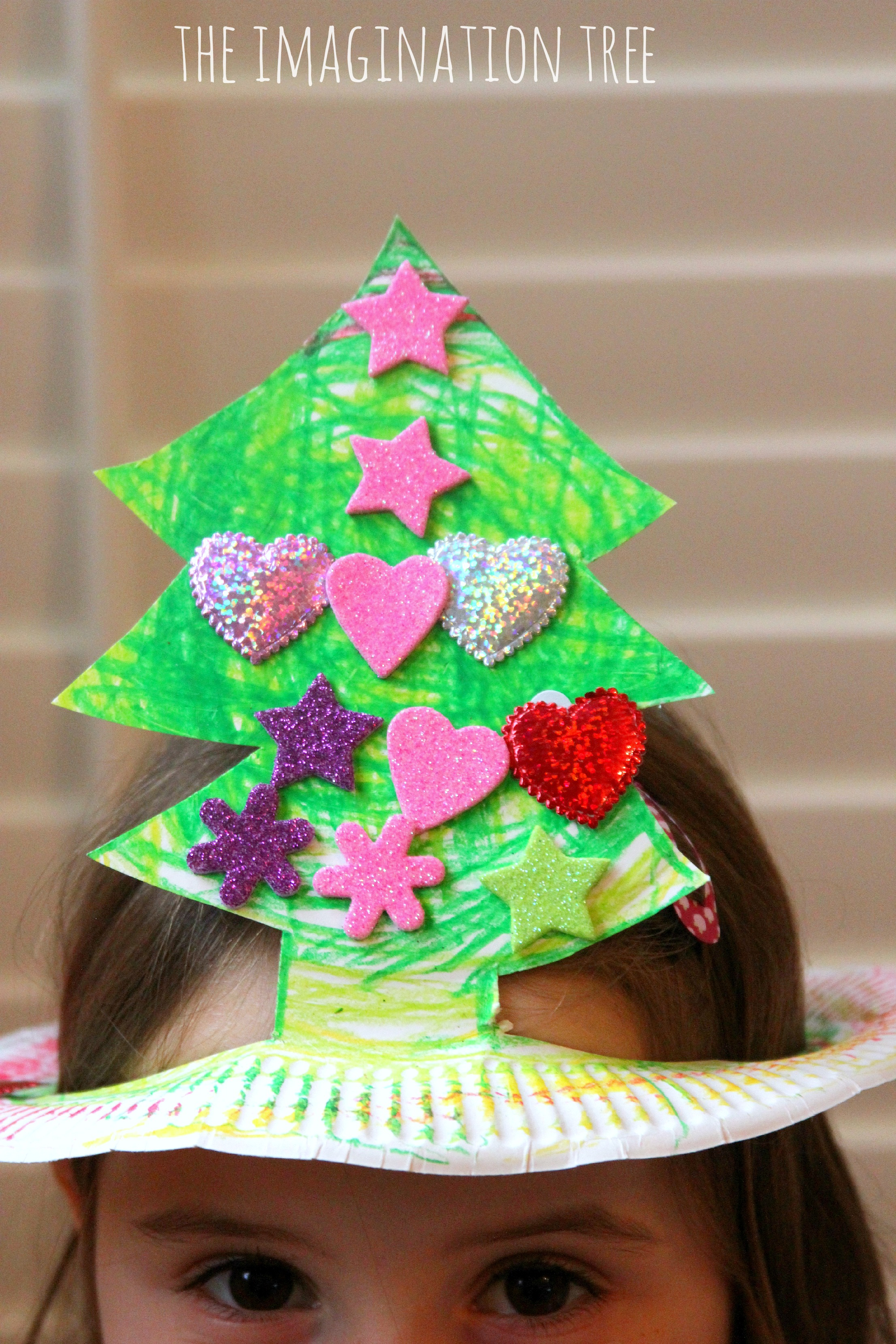 b67cd2fb64 Paper plate christmas tree hat craft