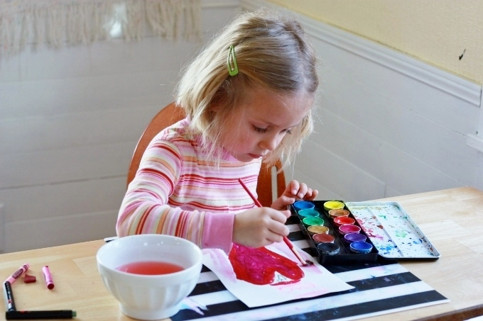 Crayon Melt Valentines Day Art for Kids - Painting over the drawing with watercolors