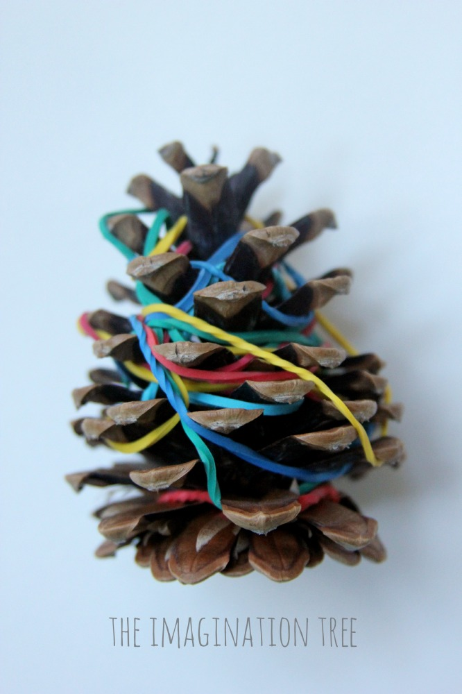 Pine cones and elastic bands fine motor skills activity