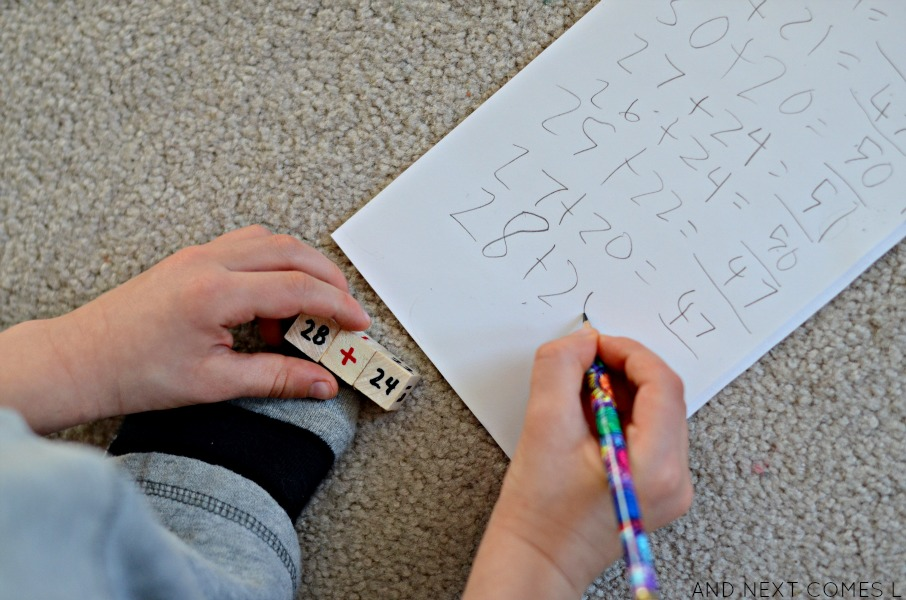 Solving math problems using DIY wooden math dice from And Next Comes L