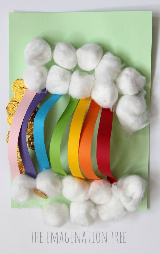 Paper rainbow sculpture with cotton ball clouds