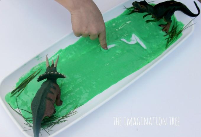 Dinosaur swamp sensory writing tray