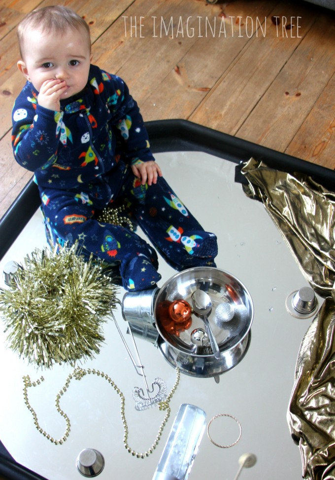 Baby heuristic play tray with shiny and metallic obejcts