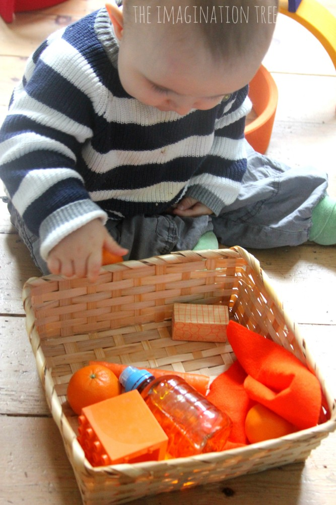 Colour themed baby sensory play basket