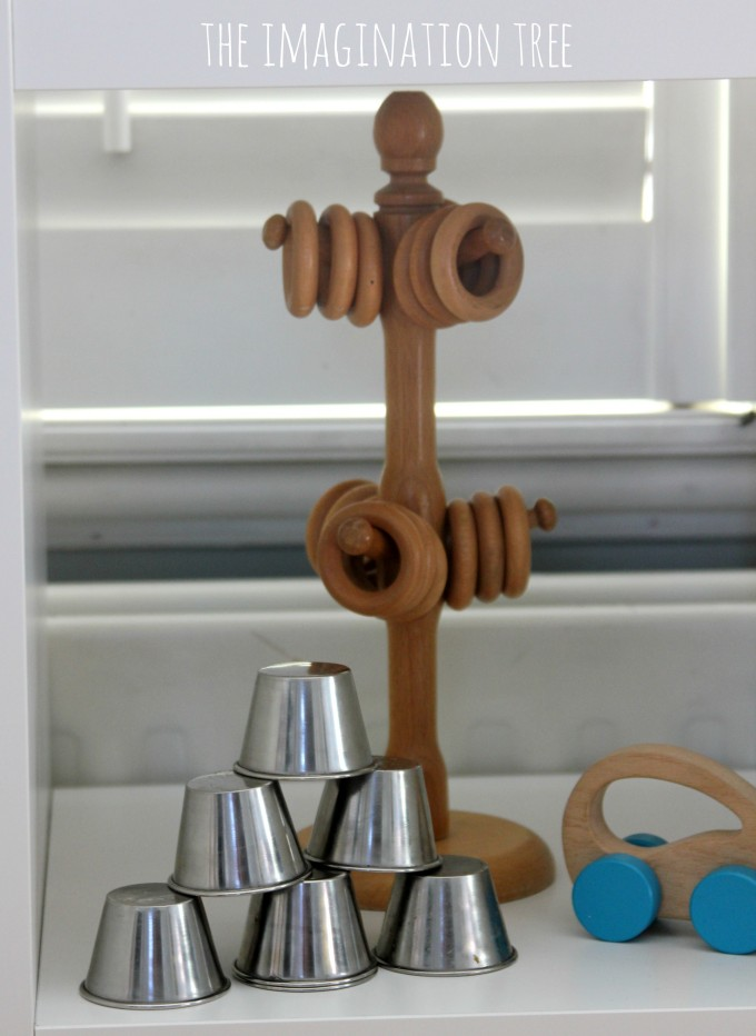 Stacking and hanging toys on baby play shelves