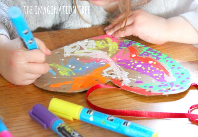 Cardboard fine motor heart decorations