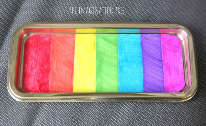 Make a rainbow sensory writing tray!