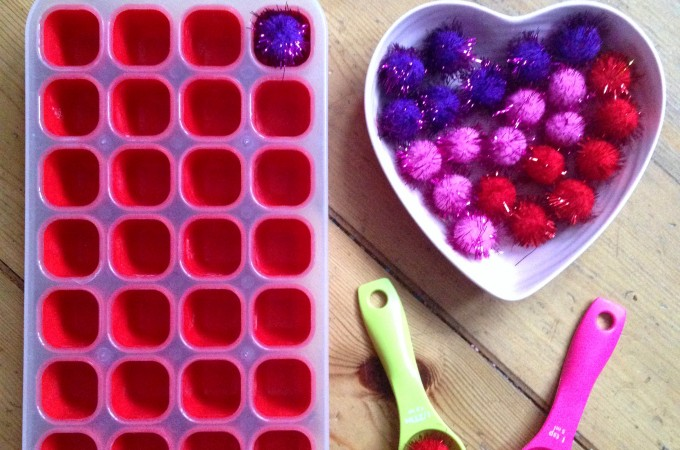 Pom pom transfer fine motor play for toddlers and preschoolers