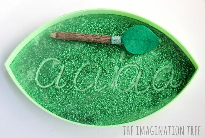 Alphabet fun with a leaf sensory writing tray!