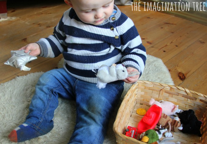 Baby and toddler play with a nursery rhyme basket