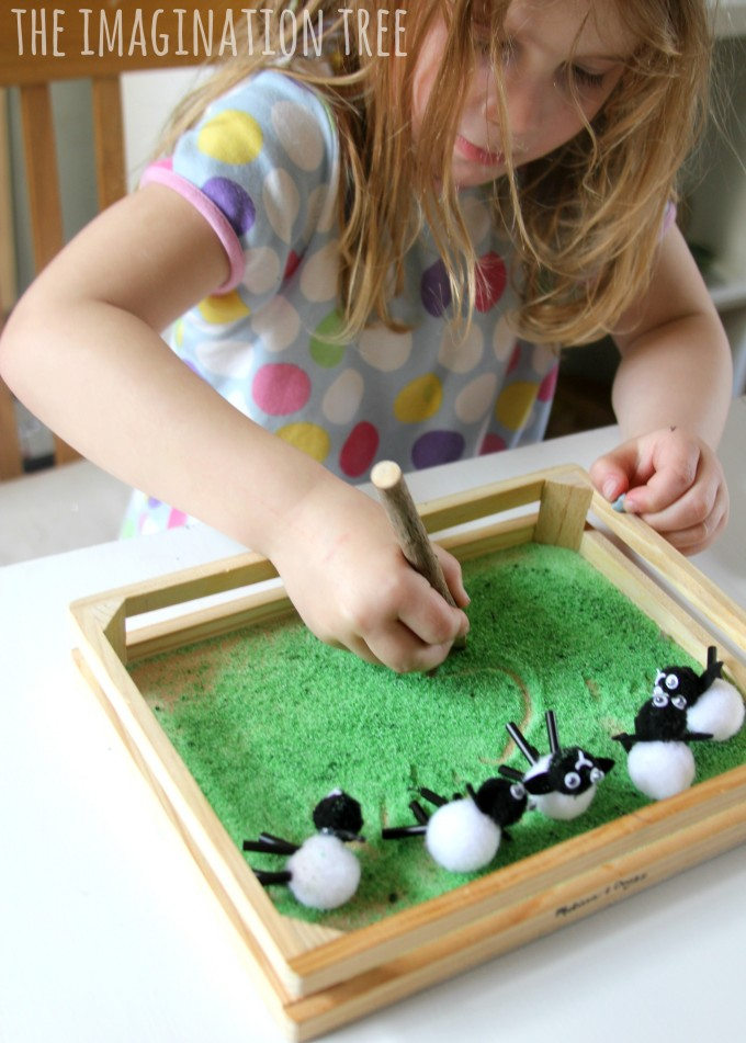 Counting in a farmyard sensory tray