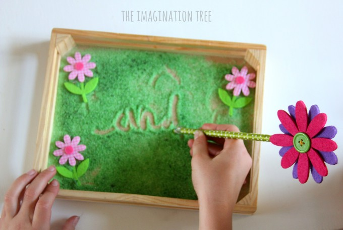 Cursive writing in a flower themed writing tray