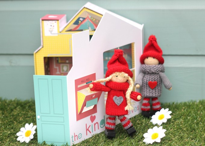 Kindness Elves mailing a letter in their home