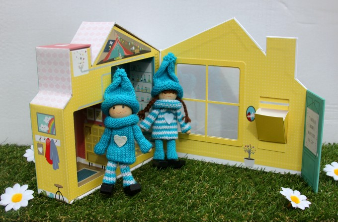 Blue kindness elves with their home